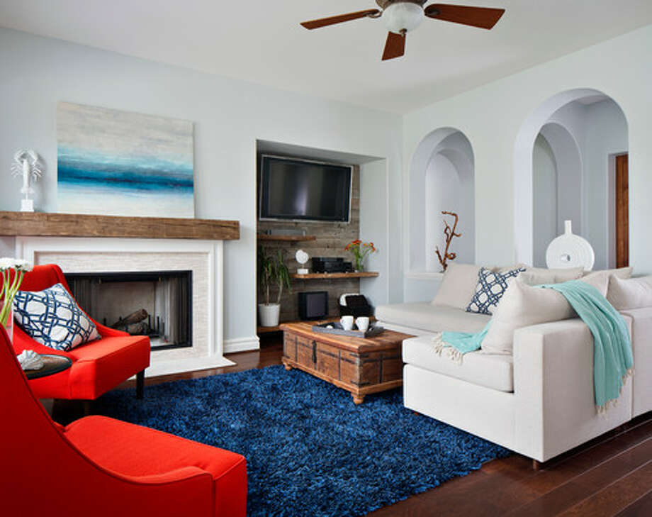 10. Use nautical color schemes with a pop artist's eye. So far I've shown rooms that are almost exclusively monochromatic, but you can have an updated look that includes bold color. The navy shag rug grounds the room here, while bright red chairs stand out atop it. The rest of the elements in the room are subdued, putting focus on the bolder elements. Photo: Houzz.com