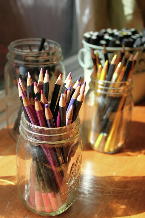 5. Organize your supplies. Organizing your materials simply and beautifully does not need to cost a lot of money. Glass jars can be washed and recycled as containers for pencils, brushes and more. Wine crates, crocks and produce bins can hold larger items — look around your home and see what you can reclaim and repurpose. Photo: Houzz.com