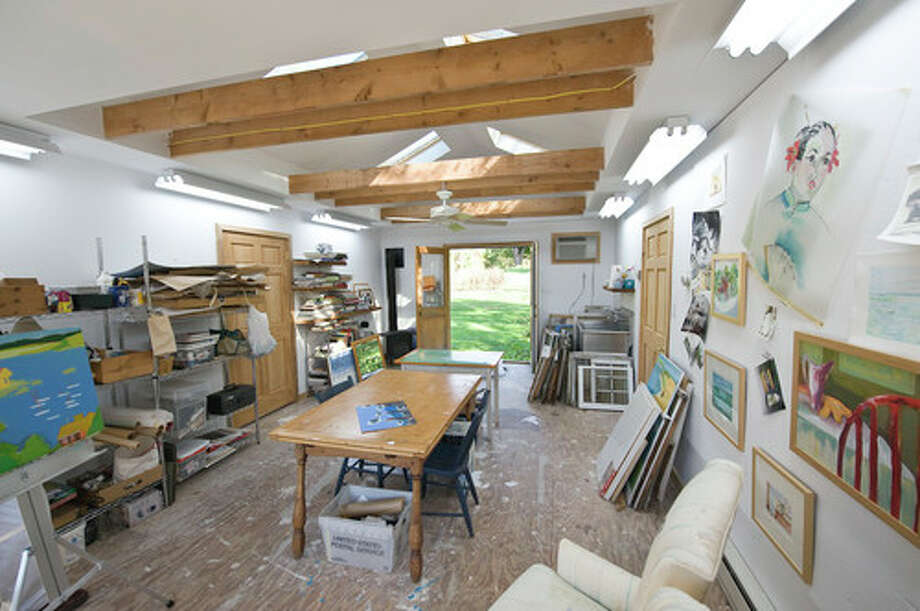 7. Consider using a garage, shed or outbuilding. Especially for those working with caustic materials or power tools, outside the main house can be the best place for your work. Be sure the room you are working in has adequate ventilation and keep any potentially dangerous materials in a locked cabinet. Photo: Houzz.com