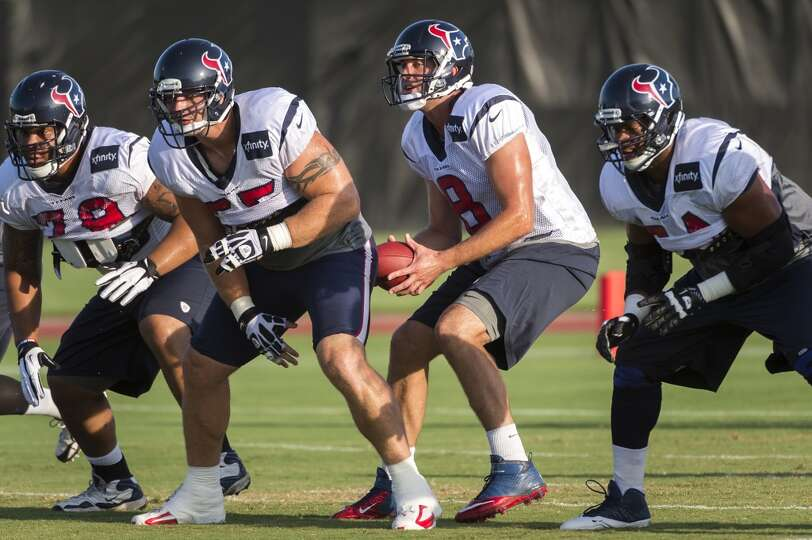 Quarterback Matt Schaub (8) takes a snap behind guard Brandon Brooks (79), center Chris Myers (55) a