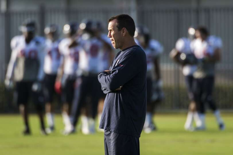Head coach Gary Kubiak watches his team work out.