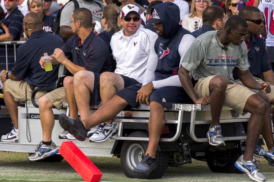 Running back Arian Foster kicks at an end zone pylon as he rides on a cart following practice. Photo: Smiley N. Pool, Chronicle