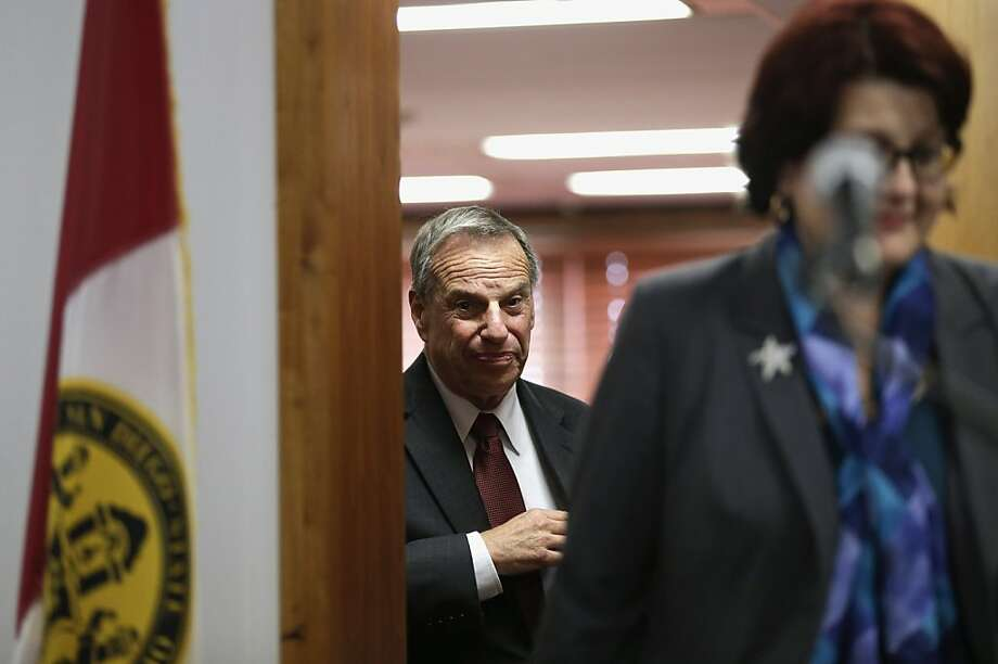 San Diego Mayor Bob Filner (center), who is facing a sexual harassment lawsuit, follows new Chief of Staff Lee Burdick as he makes his way to the podium for a news conference last month. Photo: Gregory Bull, Associated Press