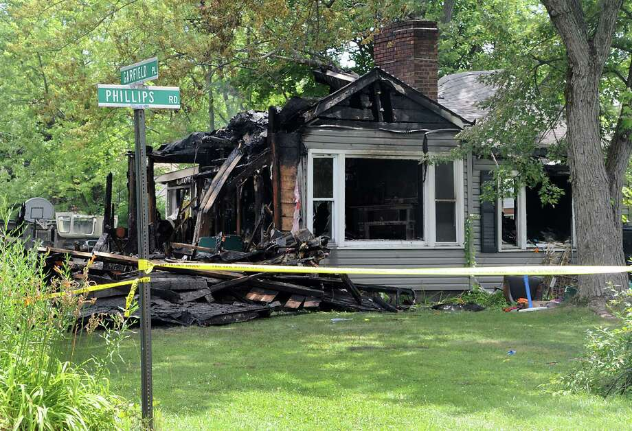 The scene at the intersection of Phillips Road and Garfield Place where  a home was destroyed by a fire overnight on Sunday, Aug, 4, 2013 in East Greenbush, N.Y.  (Lori Van Buren / Times Union) Photo: Lori Van Buren / 00023405A