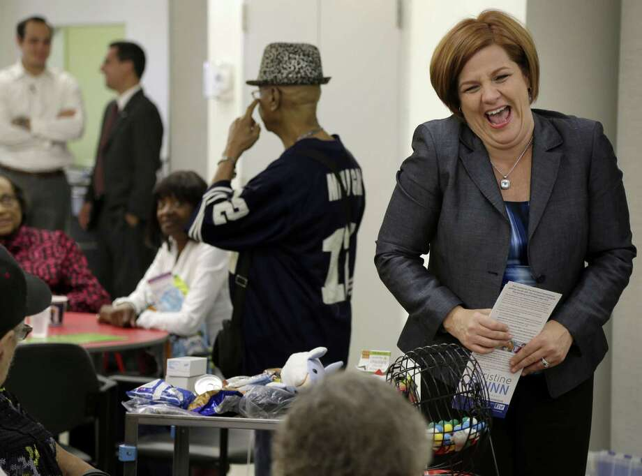 New York City mayoral candidate Christine Quinn laughs while talking with people at a Lenox Hill Neighborhood House senior center. She's back in the lead after Anthony Weiner's latest scandal cost him support. Photo: Seth Wenig, Associated Press / AP