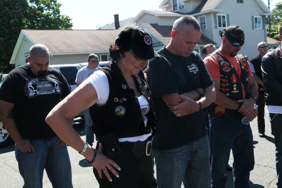 Beverley Pierson, left, joins in a moment of silence for her son, Jordan, before the 7th Annual Motorcycle Poker Run In Memory of Corporal Jordan Pierson on Sunday, Aug 4 ,2013. The riders left from  Milford Elk's Lodge and donations benefit the Marine Corps Scholarship Foundation. Corporal Jordan Pierson of Milford died while fighting in Iraq in 2006. Photo: BK Angeletti, B.K. Angeletti / Connecticut Post freelance B.K. Angeletti