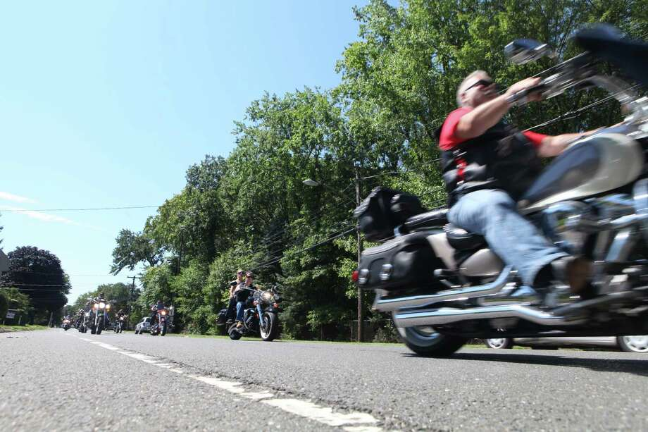 Riders head down North Ave. in the 7th Annual Motorcycle Poker Run In Memory of Corporal Jordan Pierson on Sunday, Aug 4 ,2013. The riders left from  Milford Elk's Lodge and donations benefit the Marine Corps Scholarship Foundation.  Corporal Jordan Pierson of Milford died while fighting in Iraq in 2006. Photo: BK Angeletti, B.K. Angeletti / Connecticut Post freelance B.K. Angeletti