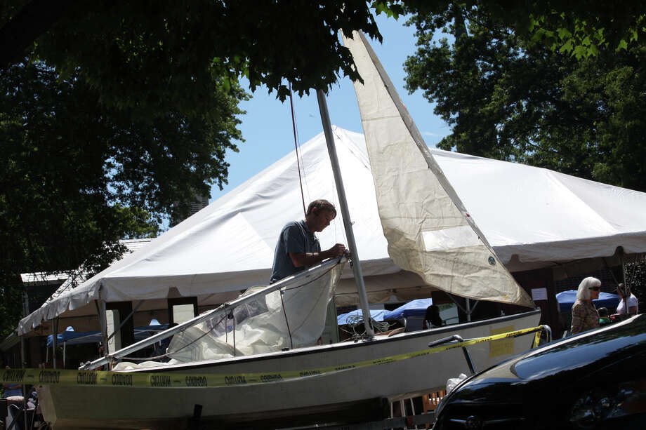 Volunteer Ned Beaver, of Fairfield, assembles sails of a boat for sale at Operation Hope's Annual Tag Sale at First Christian Church Congregational in Fairfield on Sunday, Aug. 4, 2013. Photo: BK Angeletti, B.K. Angeletti / Connecticut Post freelance B.K. Angeletti