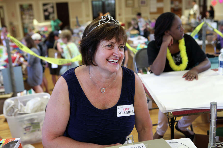 Volunteer Lisa Doocy, of Southport,  runs the cash register at Operation Hope's Annual Tag Sale at First Christian Church Congregational in Fairfield on Sunday, Aug. 4, 2013. Photo: BK Angeletti, B.K. Angeletti / Connecticut Post freelance B.K. Angeletti
