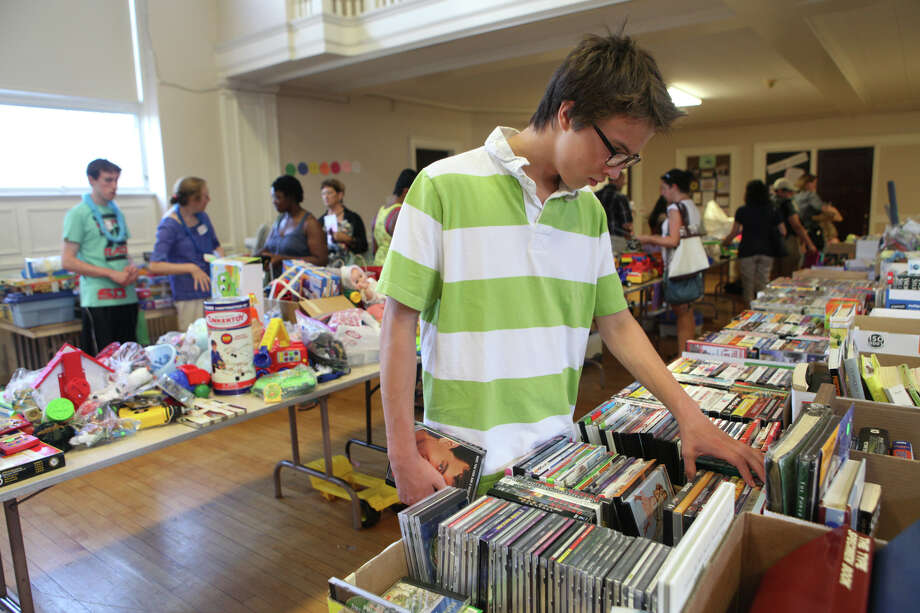 Jackson Gallati, 14, of Fairfield, shops at Operation Hope's Annual Tag Sale at First Christian Church Congregational in Fairfield on Sunday, Aug. 4, 2013. Photo: BK Angeletti, B.K. Angeletti / Connecticut Post freelance B.K. Angeletti