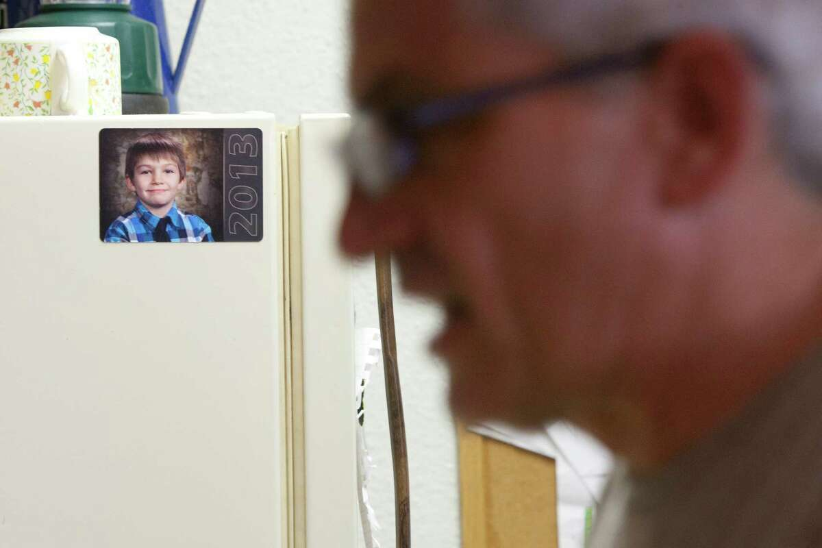 """""""He's a special boy,"""" Frank Lowrance said of his son, Noah, 8, where you can see Noah's picture throughout the one-bedroom apartment they share together Wednesday, July 31, 2013, in Spring. """"I tried to meet up with other single fathers, but they are weekend dad's,"""" Lowrance said. """"This is my world."""" Noah's mother left him when he was seven months old, leaving Frank, at the age of 42, to take over as a single father. """"I thought, 'okay God, how am I going to do this?'"""" Lowrance said. """"To me it's a privilege,"""" he said. """"I didn't grow up to be an astronaut. But I got to be a cool dad and that's better than anything."""""""