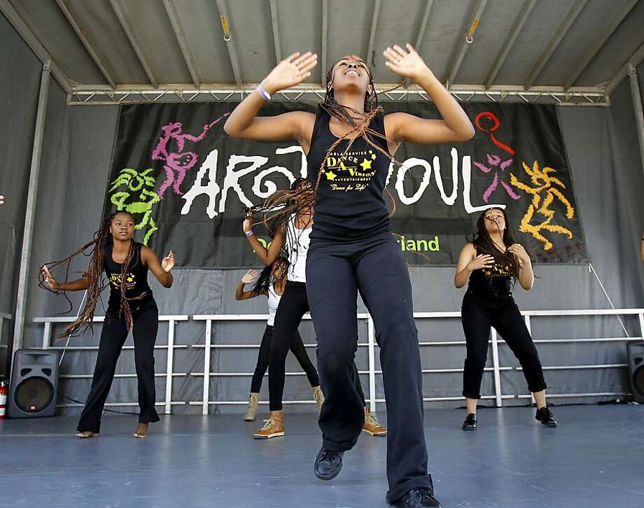 The dance group Dance-A-Vision rehearses at the Jefferson Street stage for the Art + Soul street party in Oakland. Photo: Brant Ward, The Chronicle