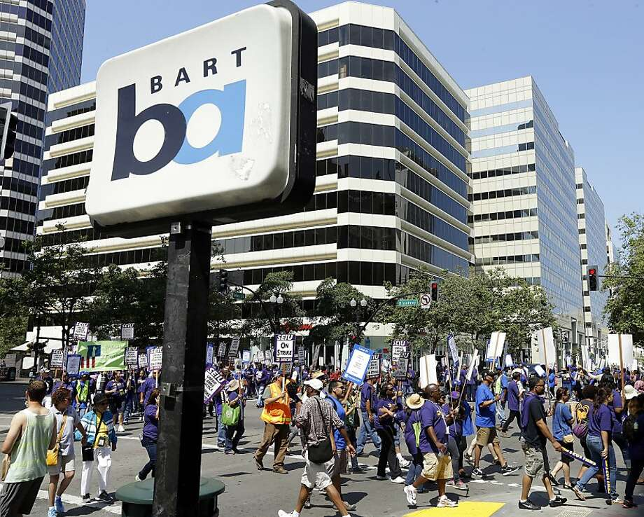 In this file photo from Monday, July 1, 2013, striking Bay Area Rapid Transit workers picket as they close the intersection of 14th & Broadway on Monday, July 1, 2013, in downtown Oakland, Calif. Photo: Ben Margot, Associated Press