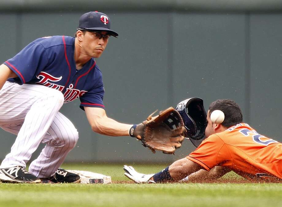 August 4: Twins 3, Astros 2Twins shortstop Doug Bernier makes a catch but Jose Altuve slides safely on a steal to second base in the third inning. Photo: Andy Clayton-King, Associated Press