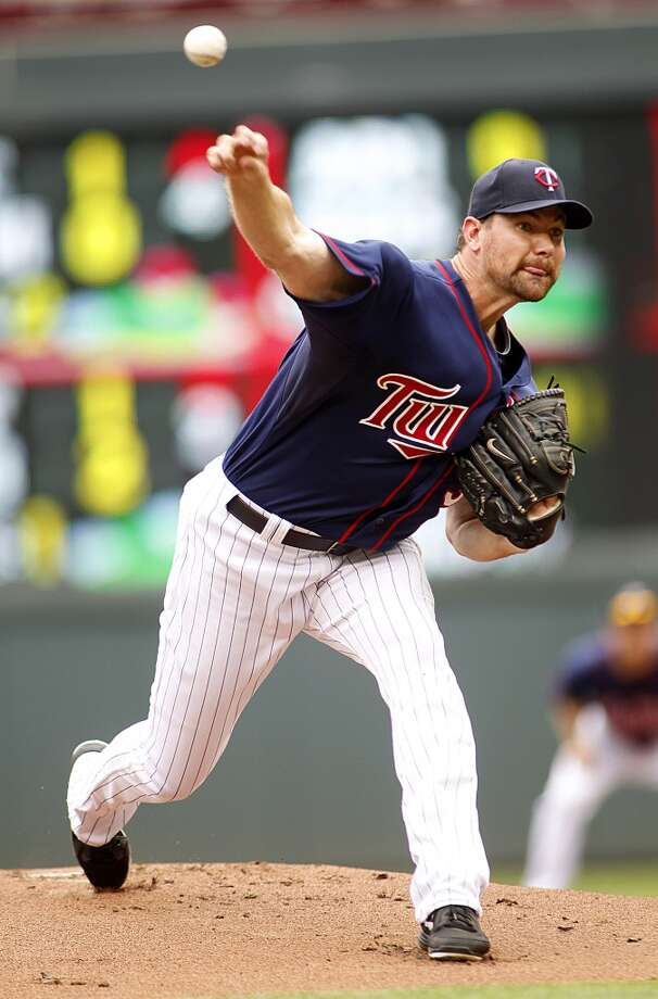 Twins starting pitcher Mike Pelfrey allowed two runs on seven hits in five innings. Photo: Andy Clayton-King, Associated Press