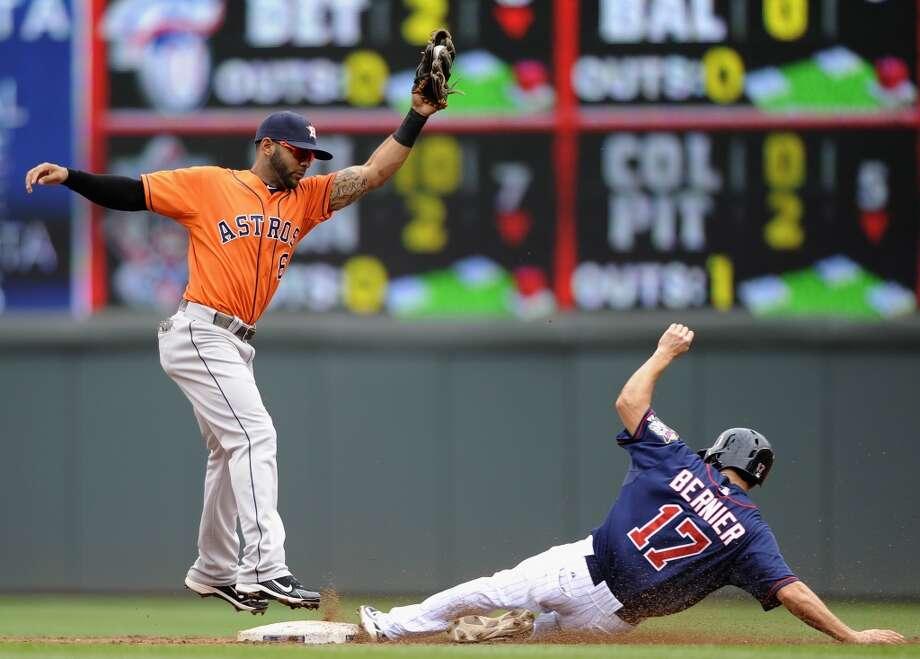 Doug Bernier steals second base as Jonathan Villar fields the ball during the third inning. Photo: Hannah Foslien, Getty Images