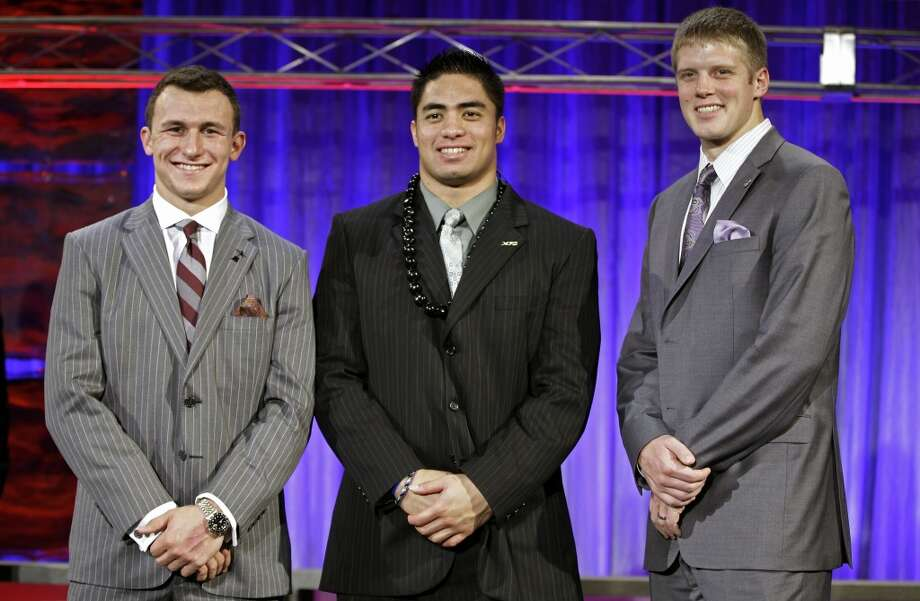 Texas A&M quarterback Johnny Manziel poses with other Heisman finalists, Manti Te'o of Notre Dame and Kansas State quarterback Collin Klein Photo: John Raoux, Associated Press