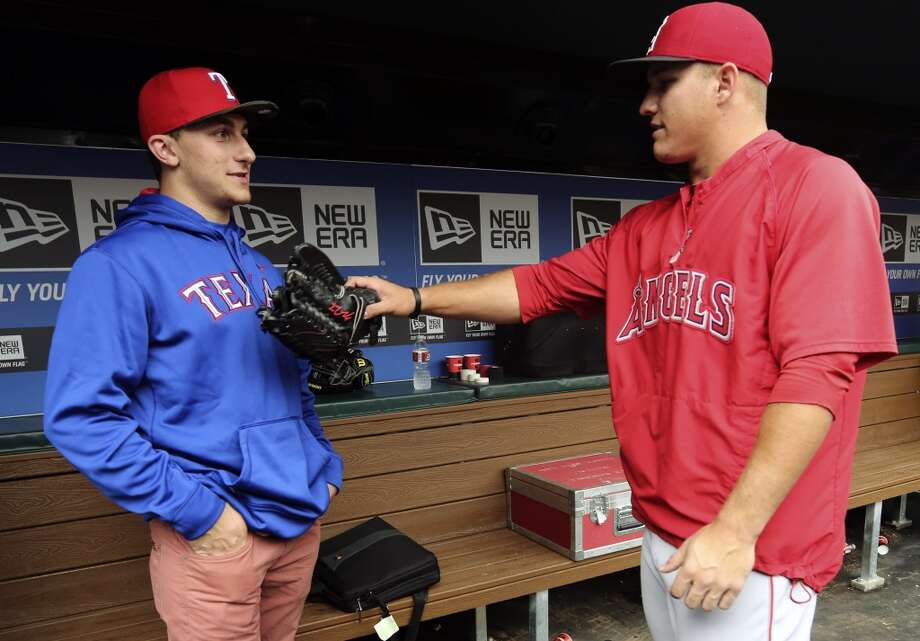 Texas A&M quarterback Johnny Manziel speaks with Angels All-Star outfielder Mike Trout before throwing out the first pitch at a Rangers game. Photo: LM Otero, Associated Press