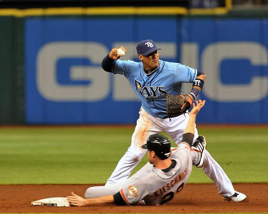 Tampa Bay shortstop Yunel Escobar forces Roger Kieschnick in the second. Photo: Al Messerschmidt, Getty Images