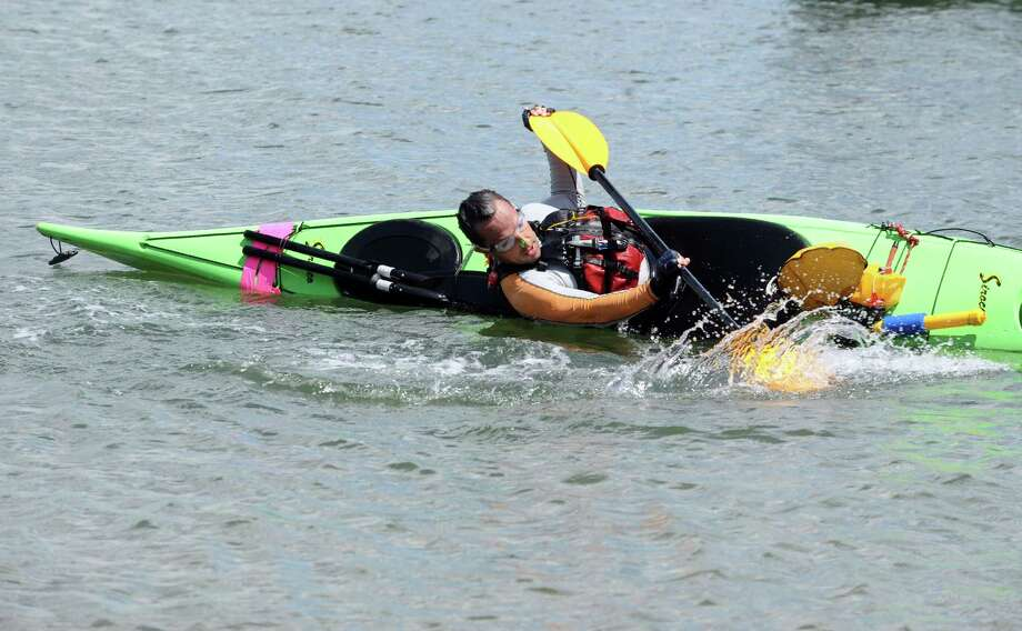 Jorge Gonzalez, of Byram, practices rolling over his kayak in the water at Greenwich Point Park in Greenwich, Conn., Sunday, August 4, 2013. Photo: Helen Neafsey / Greenwich Time