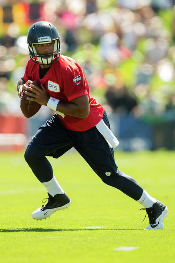 Quarterback Russell Wilson prepares to throw to a teammate during a drill at the opening day of Seahawks training camp July 25, 2013, at the Virginia Mason Athletic Center in Renton. Photo: Jordan Stead, Seattlepi.com / SEATTLEPI.COM