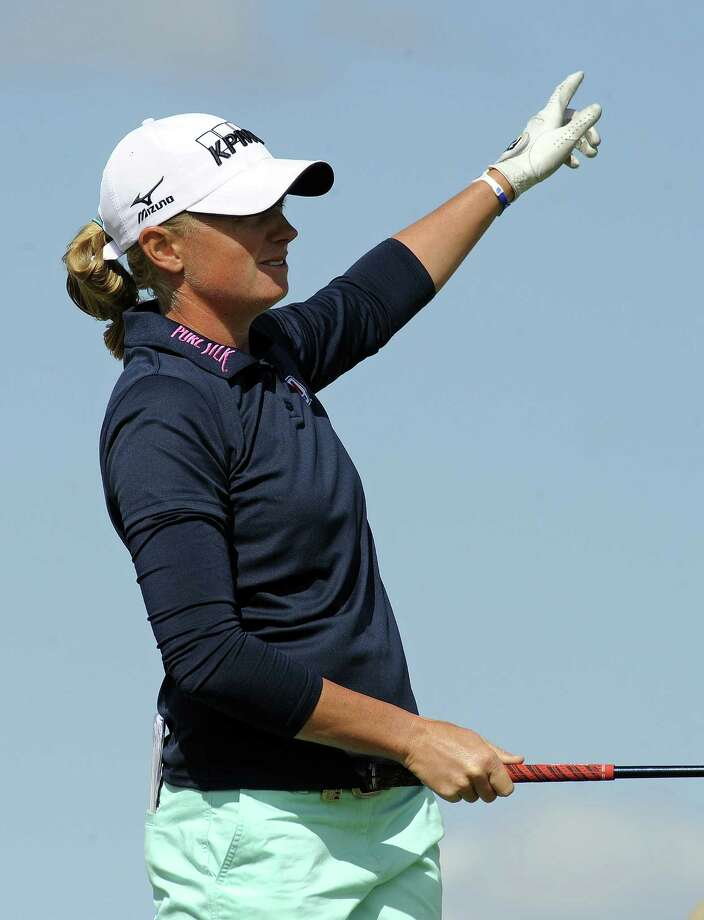 US golfer Stacy Lewis watches her tee shot from the 12th tee during the final round of the women's British Open Golf Championship at the Old Course in St Andrews, Scotland, on August 4, 2013. US golfer Stacy Lewis won the women's British Open on Sunday by two shots. Lewis, the winner of the 2011 Kraft Nabisco Championship, collected her second major with a final round 72 for an eight-under-par total of 280. AFP PHOTO/ANDY BUCHANANAndy Buchanan/AFP/Getty Images Photo: ANDY BUCHANAN / AFP
