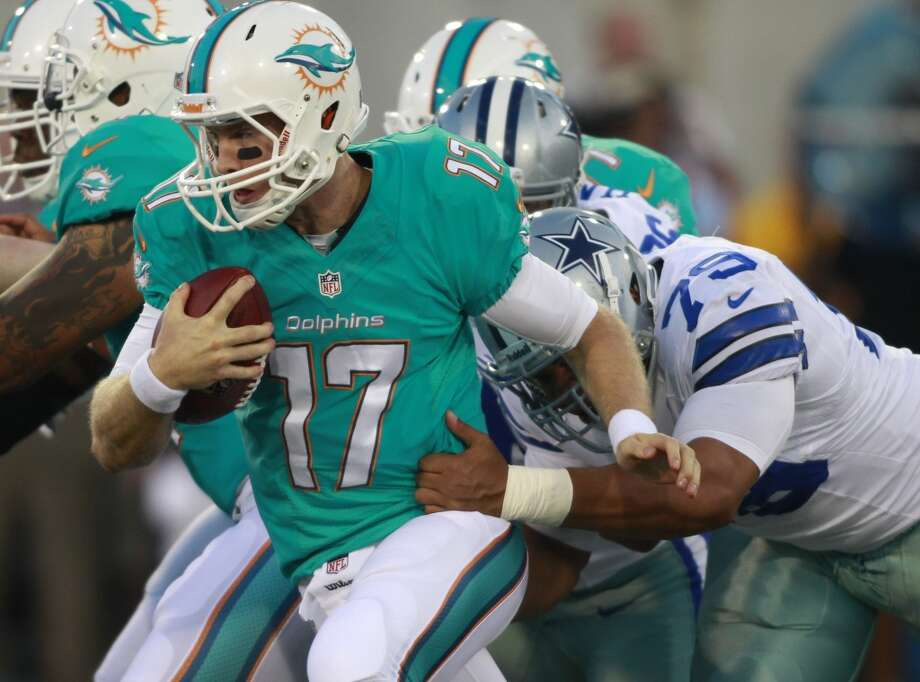 Miami Dolphins quarterback Ryan Tannehill (17) runs for one yard in the first quarter against the Dallas Cowboys at the Pro Football Hall of Fame exhibition football game Sunday, Aug. 4, 2013, in Canton, Ohio. (AP Photo/Scott R. Galvin) Photo: Scott R. Galvin, Associated Press