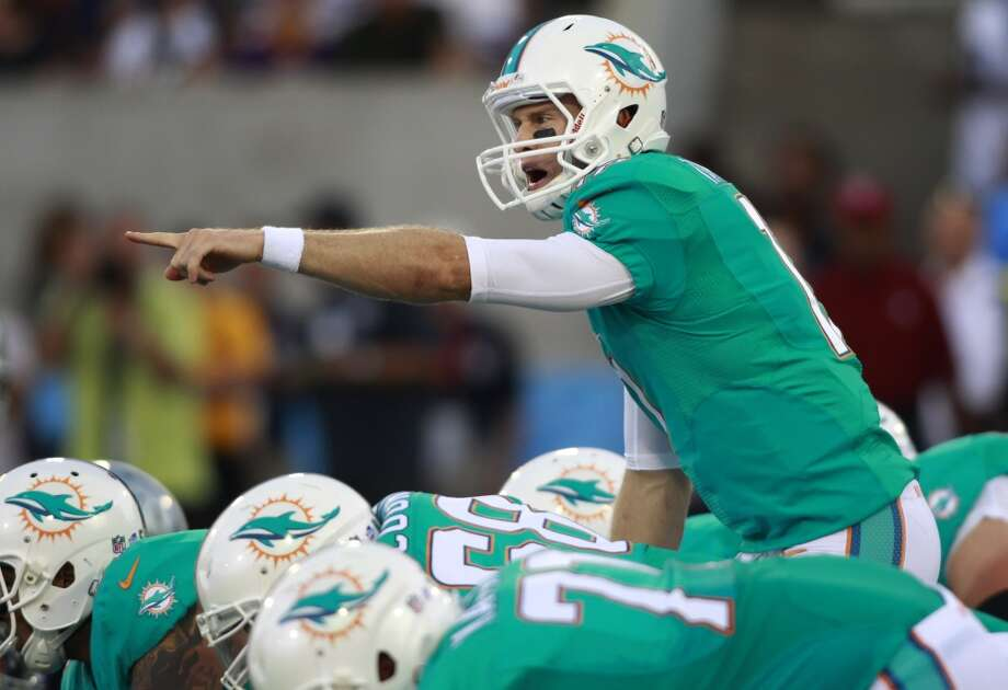 Miami Dolphins quarterback Ryan Tannehill gives instructions during the first quarter against the Dallas Cowboys at the Pro Football Hall of Fame exhibition football game Sunday, Aug. 4, 2013, in Canton, Ohio. (AP Photo/Scott R. Galvin) Photo: Scott R. Galvin, Associated Press