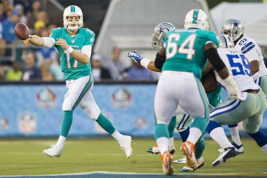 Quarterback Ryan Tannehill #17 of the Miami Dolphins throws away a pass during the first quarter against the Dallas Cowboys at Fawcett Stadium on August 4, 2013 in Canton, Ohio. (Jason Miller / Getty Images) Photo: Jason Miller, Getty Images