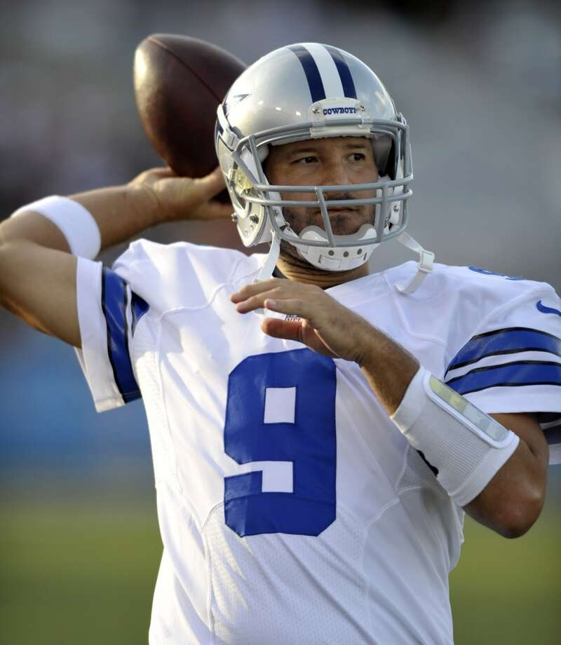 Dallas Cowboys quarterback Tony Romo warms up before the Cowboys play the Miami Dolphins at the Pro Football Hall of Fame exhibition football game Sunday, Aug. 4, 2013, in Canton, Ohio. (AP Photo/David Richard) Photo: David Richard, Associated Press