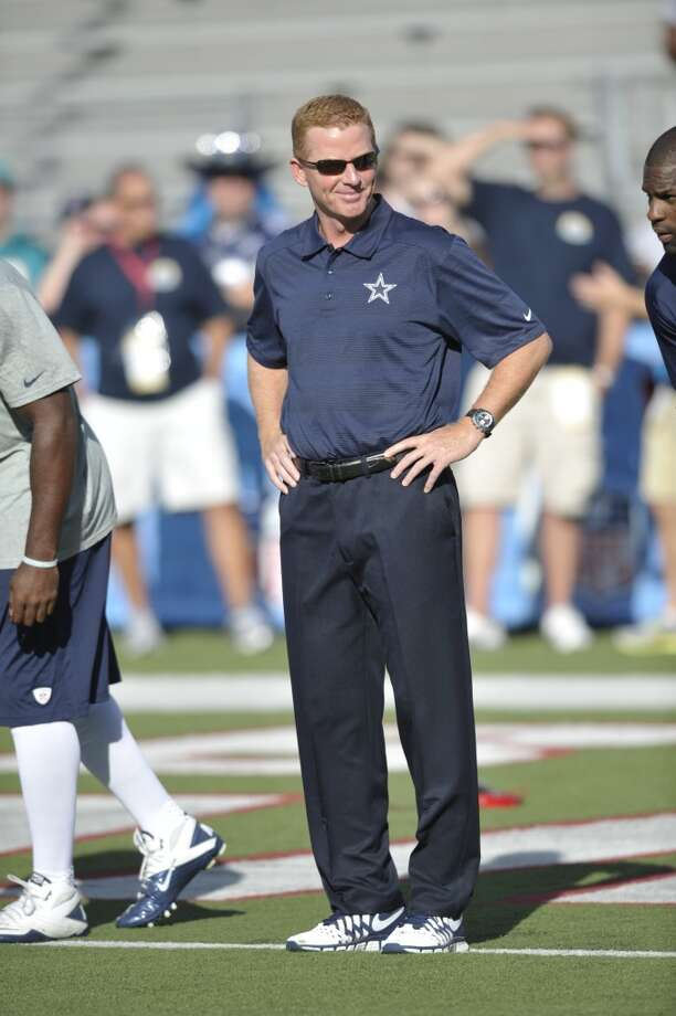 Dallas Cowboys head coach Jason Garrett watches as players warm up before the Cowboys play the Miami Dolphins at the Pro Football Hall of Fame exhibition football game Sunday, Aug. 4, 2013, in Canton, Ohio. (AP Photo/David Richard) Photo: David Richard, Associated Press