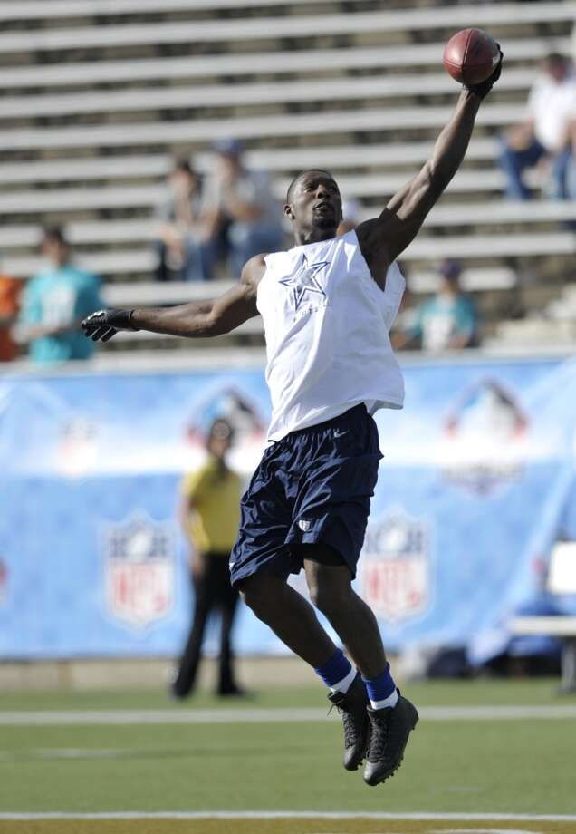Dallas Cowboys wide receiver Dez Bryant catches a pass before the Cowboys play the Miami Dolphins at the Pro Football Hall of Fame exhibition football game Sunday, Aug. 4, 2013, in Canton, Ohio. (AP Photo/David Richard) Photo: David Richard, Associated Press