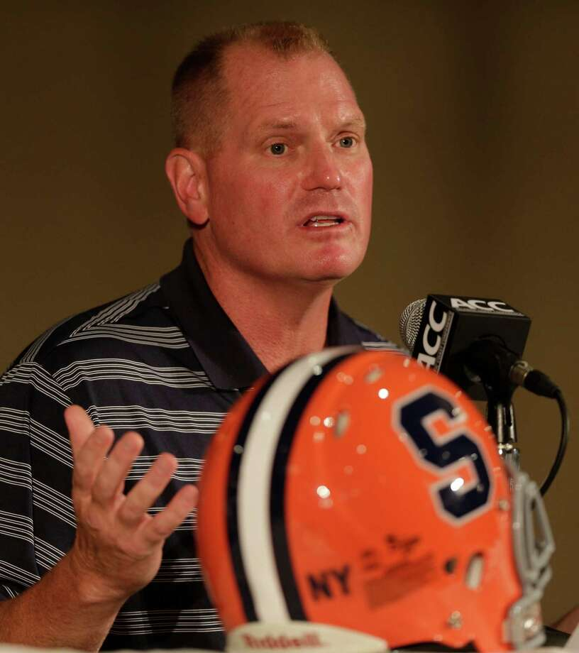 Syracuse head coach Scott Shafer speaks to the media at a news conference during the Atlantic Coast Conference college football media day in Greensboro, N.C., Monday, July 22, 2013. (AP Photo/Chuck Burton) ORG XMIT: NCCB116 Photo: Chuck Burton / AP