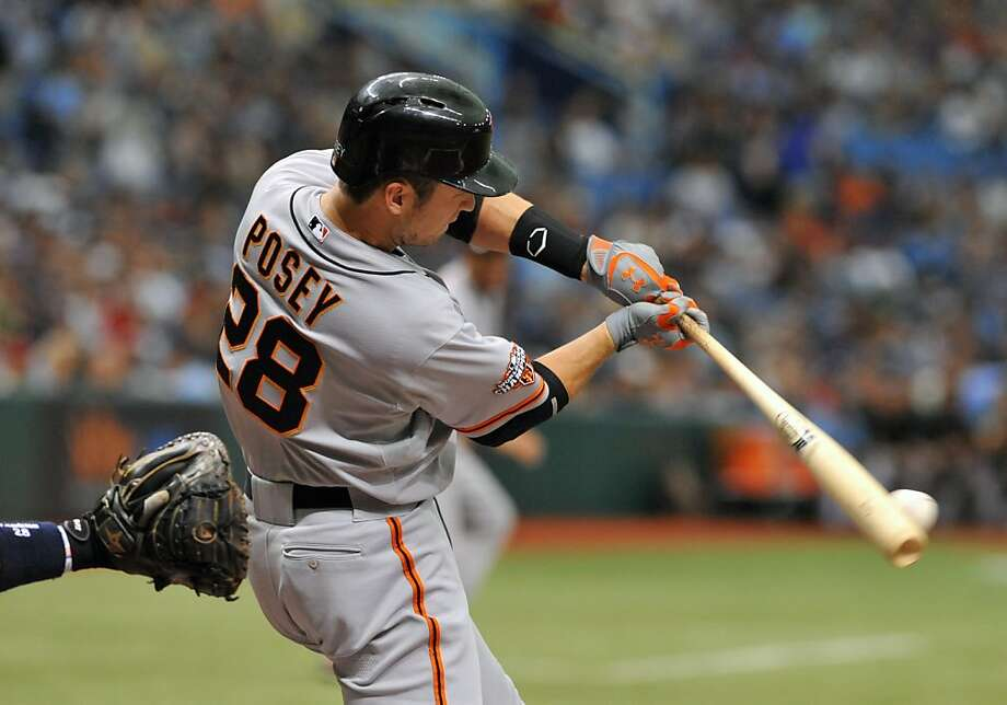 ST. PETERSBURG, FL - AUGUST 4:  Designated hitter Buster Posey #28 of the San Francisco Giants bats in the first inning against the Tampa Bay Rays August 4, 2013 at Tropicana Field in St. Petersburg, Florida. (Photo by Al Messerschmidt/Getty Images) Photo: Al Messerschmidt, Getty Images