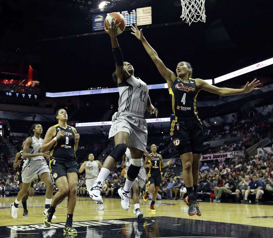 The Silver Stars' Shenise Johnson goes up for a shot as Tulsa's Skylar Diggins defends during the first half at the AT&T Center. Johnson finished with five points. Diggins, the third pick in the 2013 draft, was scoreless. Photo: Edward A. Ornelas / San Antonio Express-News