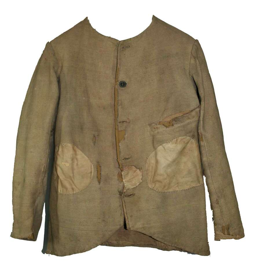 Confederate Jacket, c. 1864.  James Hughes of the 4th New York Heavy Artillery wore this jacket for six months and four days while confined at North CarolinaOs Salisbury Prison.  Captured at the Second Battle of ReamOs Station during the siege of Petersburg on August 25, 1864 along with 325 other members of his regiment, each prisoner was stripped of his clothing, money and other valuables and provided with Confederate cast-offs such as this jacket before being transferred to Salisbury and other Confederate prison camps.  Hughes was paroled on February 28, 1865, but at least 42 soldiers from his regiment died in the overcrowded prison.  (Courtesy New York State Military Museum)