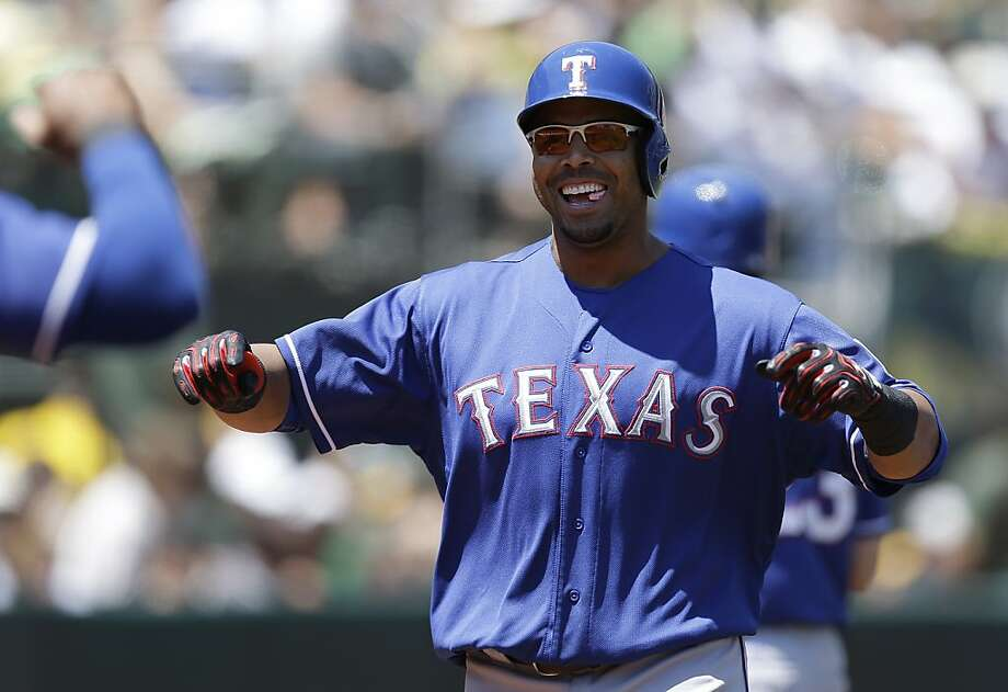 Texas Rangers' Nelson Cruz celebrates after hitting a home run off Oakland Athletics' A.J. Griffin in the first inning of a baseball game, Sunday, Aug. 4, 2013, in Oakland, Calif. (AP Photo/Ben Margot) Photo: Ben Margot, Associated Press
