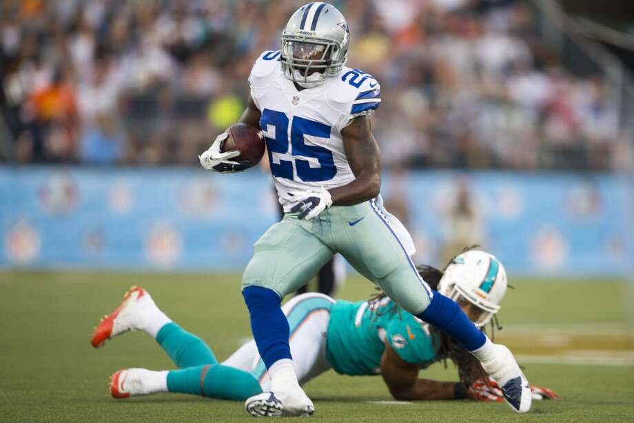 Running back Lance Dunbar #25 of the Dallas Cowboys beats a Miami Dolphins defender for a gain during the first quarter at Fawcett Stadium on August 4, 2013 in Canton, Ohio. (Jason Miller / Getty Images) Photo: Jason Miller, Getty Images
