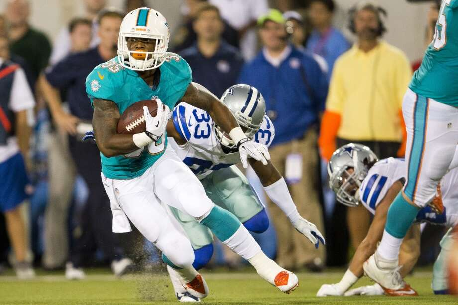 Running back Mike Gillislee #35 of the Miami Dolphins runs out a pass reception for a gain against the Dallas Cowboys during the second quarter at Fawcett Stadium on August 4, 2013 in Canton, Ohio. (Jason Miller / Getty Images) Photo: Jason Miller, Getty Images