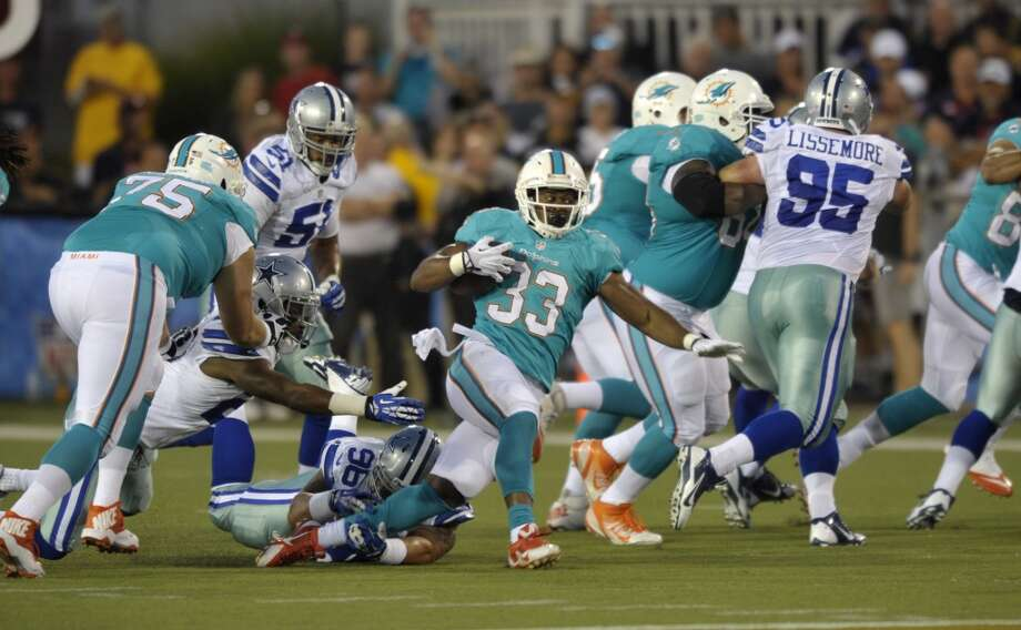 Miami Dolphins running back Daniel Thomas (33) runs the ball against the Dallas Cowboys in the first quarter at the Pro Football Hall of Fame exhibition football game Sunday, Aug. 4, 2013, in Canton, Ohio. (AP Photo/David Richard) Photo: David Richard, Associated Press