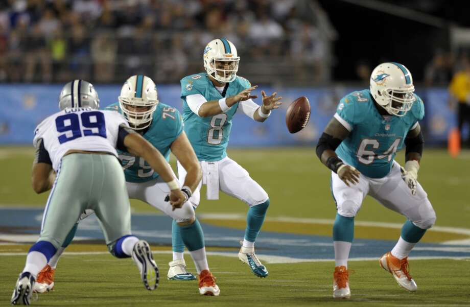 Miami Dolphins quarterback Matt Moore (8)takes a snap in the second quarter against the Dallas Cowboys at the Pro Football Hall of Fame exhibition football game Sunday, Aug. 4, 2013, in Canton, Ohio. (AP Photo/David Richard) Photo: David Richard, Associated Press