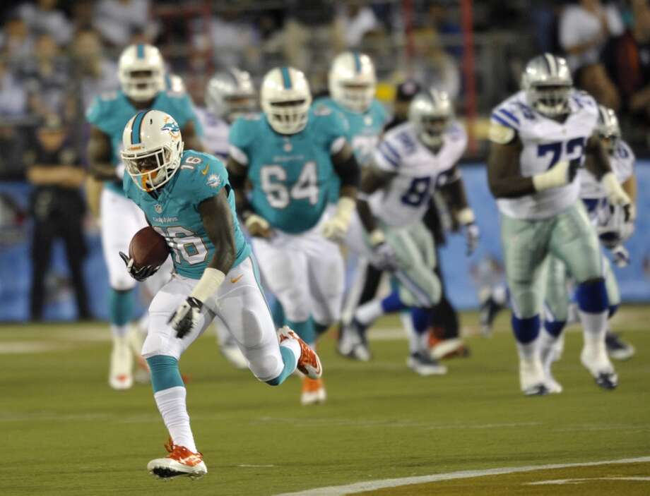 Miami Dolphins wide receiver Chad Bumphis (16) runs the ball for a first down after a catch in the second quarter against the Dallas Cowboys at the Pro Football Hall of Fame exhibition football game Sunday, Aug. 4, 2013, in Canton, Ohio. (AP Photo/David Richard) Photo: David Richard, Associated Press