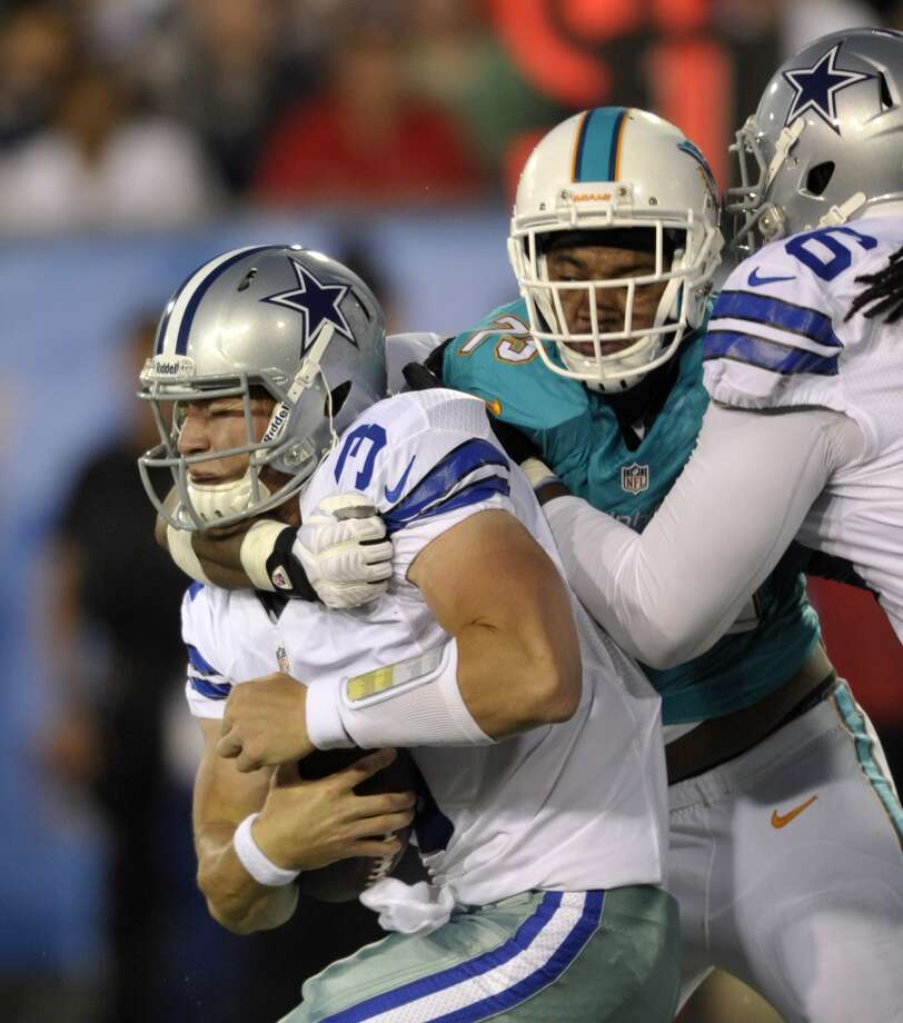 Dallas Cowboys quarterback Nick Stephens (3) is tackled by the Miami Dolphins defender in the first quarter at the Pro Football Hall of Fame exhibition football game Sunday, Aug. 4, 2013, in Canton, Ohio. (AP Photo/David Richard) Photo: David Richard, Associated Press