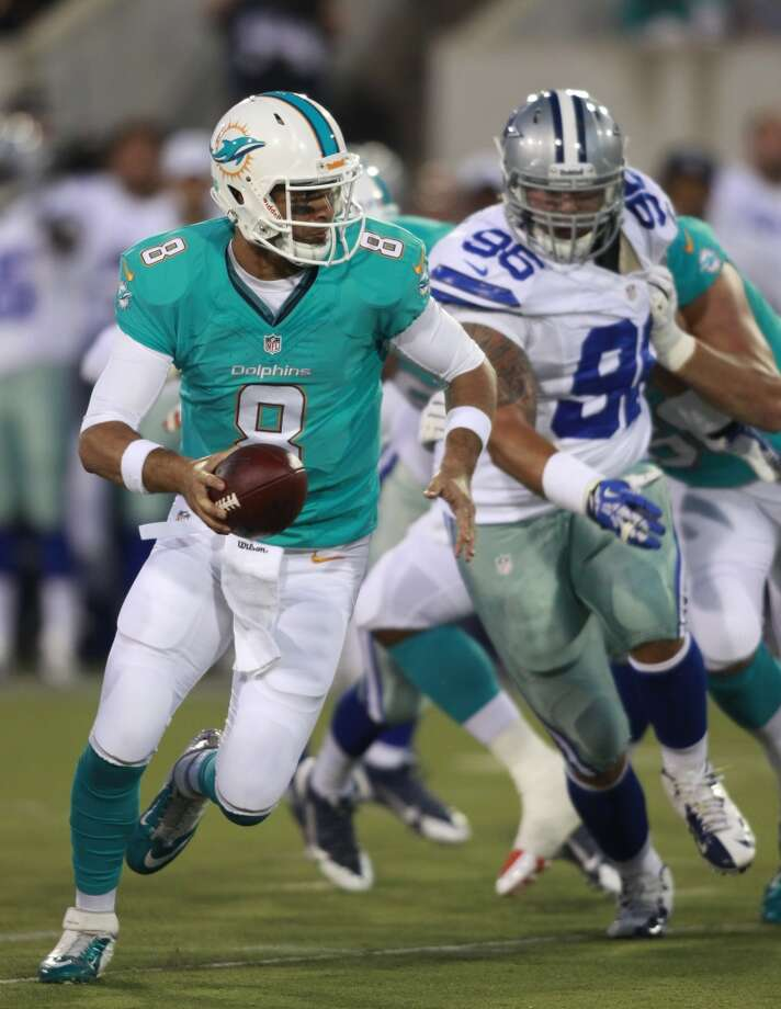 Miami Dolphins quarterback Matt Moore (8) runs the ball against the Dallas Cowboys in the first quarter at the Pro Football Hall of Fame exhibition football game, Sunday, Aug. 4, 2013, in Canton, Ohio. (AP Photo/Scott R. Galvin) Photo: Scott R. Galvin, Associated Press