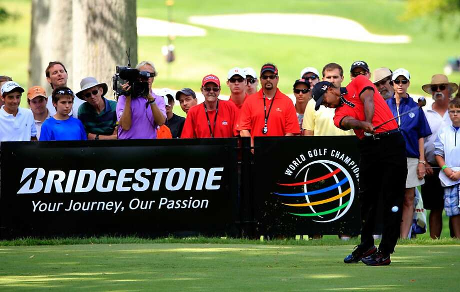 Tiger Woods tees off on the 11th after he made his only birdie of the final round. Woods won for the eighth time at Firestone Country Club, duplicating a feat he accomplished at Bay Hill. Photo: Sam Greenwood, Getty Images