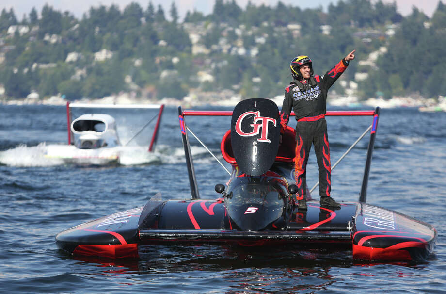 Jimmy Shane stands on his Graham Trucking boat after winning the Albert Lee Appliance Cup during the final day of Seafair on Sunday, August 4, 2013 on Lake Washington. Tens of thousands came out to enjoy a final sunny day of Seafair. Click the expand arrow, right, for larger images. Photo: JOSHUA TRUJILLO, SEATTLEPI.COM / SEATTLEPI.COM