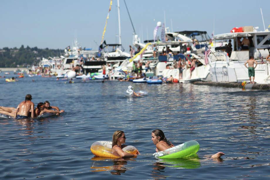 Swimmers gather on the log boom. Photo: JOSHUA TRUJILLO, SEATTLEPI.COM / SEATTLEPI.COM