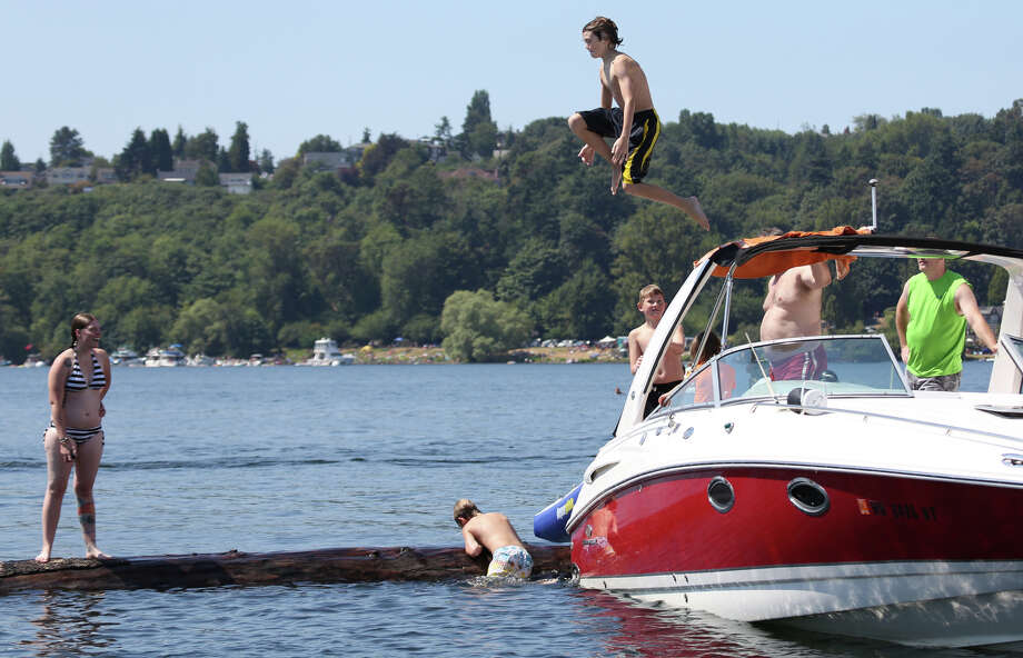 A young participant leaps from a boat. Photo: JOSHUA TRUJILLO, SEATTLEPI.COM / SEATTLEPI.COM