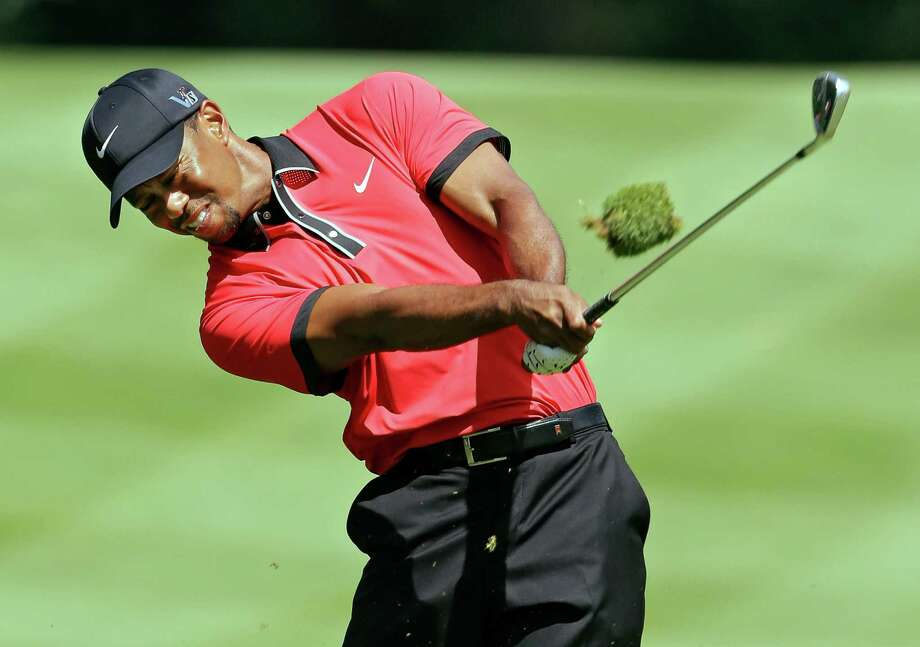 Tiger Woods hits to the sixth green during the final round of the Bridgestone Invitational golf tournament Sunday, Aug. 4, 2013 at Firestone Country Club in Akron, Ohio. (AP Photo/Mark Duncan) ORG XMIT: OHMD105 Photo: Mark Duncan / AP