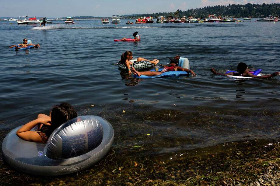 Attendees relax on inflatables and in the waters of Lake Washington. Photo: JORDAN STEAD, SEATTLEPI.COM / SEATTLEPI.COM